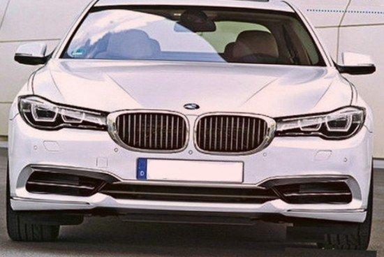 BMW 7-Series белого цвета, вид спереди