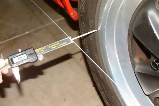 Измерение расстояния от обода до шнура